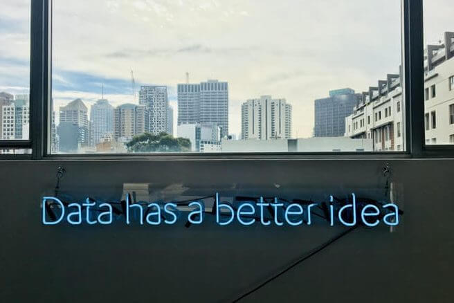 "A sign in a business says ""data has a better idea,"" on how to analyze retail sales trends"
