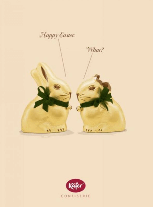 Two chocolate bunnies say hello to each other