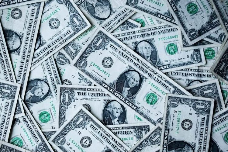 How to Qualify for a Small Business Loan with a pile of dollar bills