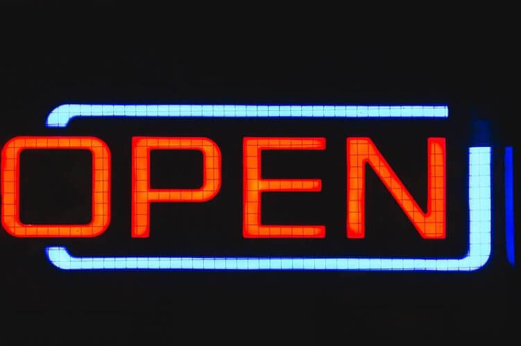 """How to plan a grand opening with a neon sign reading """"open"""""""