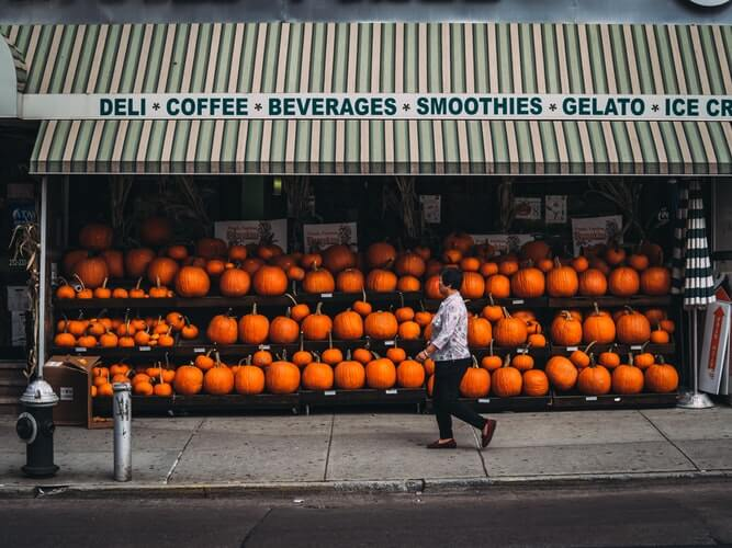Storefront display with hundreds of pumpkins