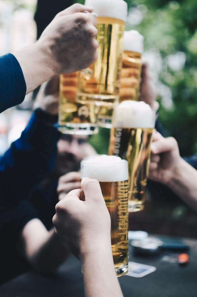Group making a cheers with beers on St. Patrick's Day celebration