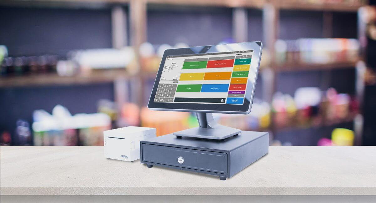 POS desktop with receipt printer at a small business checkout counter