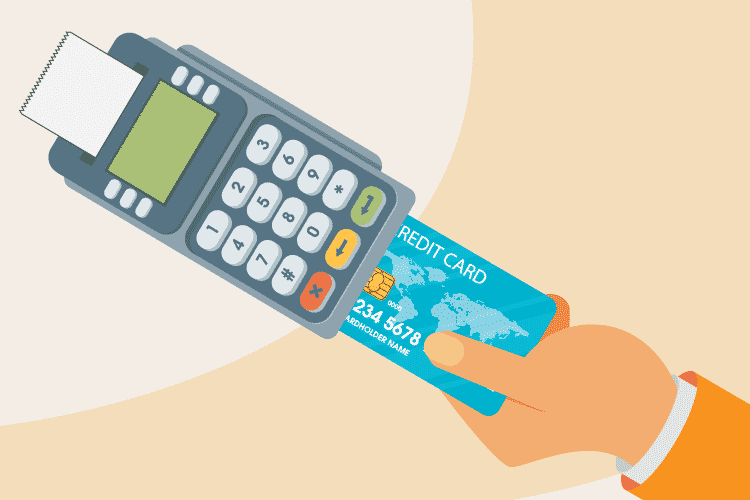 Person enters their chip and PIN credit card into an EMV terminal